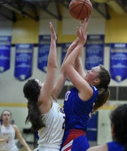 Reno's Gracen McGwire shoots with Reed's Tori Baer covering her at Reed  on Jan. 22.