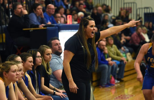 Reed girls basketball coach Sara Schopper-Ramirez is seen while taking on Reno on Feb. 8.