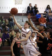Pavilion's Luke Milligan drives to the basket against Keshequa.