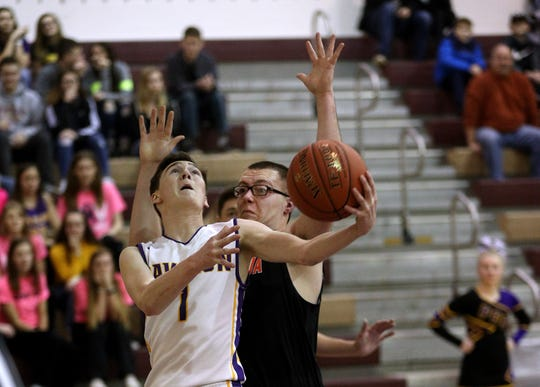 Pavilion's Colby Tillotson (1) shoots from under the basket against Keshequa's Jacob Gilbson.