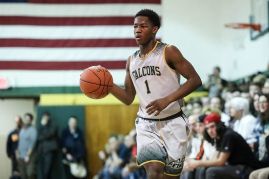 Markus Robinson (1) of C.G. Finney looks for a teammate against Northstar Christian Academy during a Section V high school boys basketball game earlier this month.