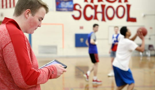Fairport senior Nick Parker watches every move during  basketball practice and uses his love of math to produce valuable information through analytics.