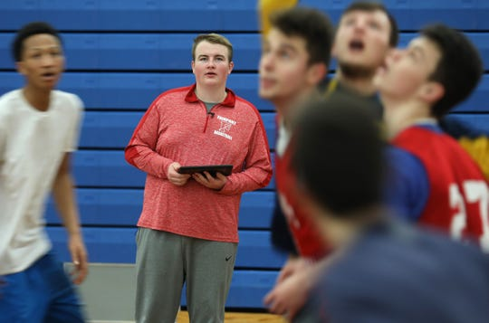 Nick Parker watches every move during Fairport boys basketball practice. Parker, a senior, provides coach Scott Fitch and his teammates with valuable information through analytics.