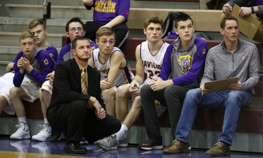 Zach Wiedrich, second from right, now cheers on his Pavilion teammates after being diagnosed with a rare heart disease. Wiedrich can no longer play competitive basketball but hopes to play baseball in the spring.