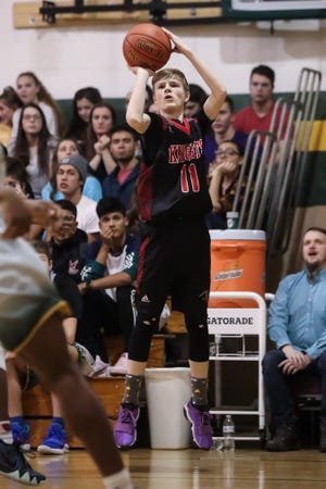 Ryan Garwood (11) of Northstar Christian Academy shoots a three against C.G. Finney during a Section V high school boys basketball game at C.G. Finney High School.