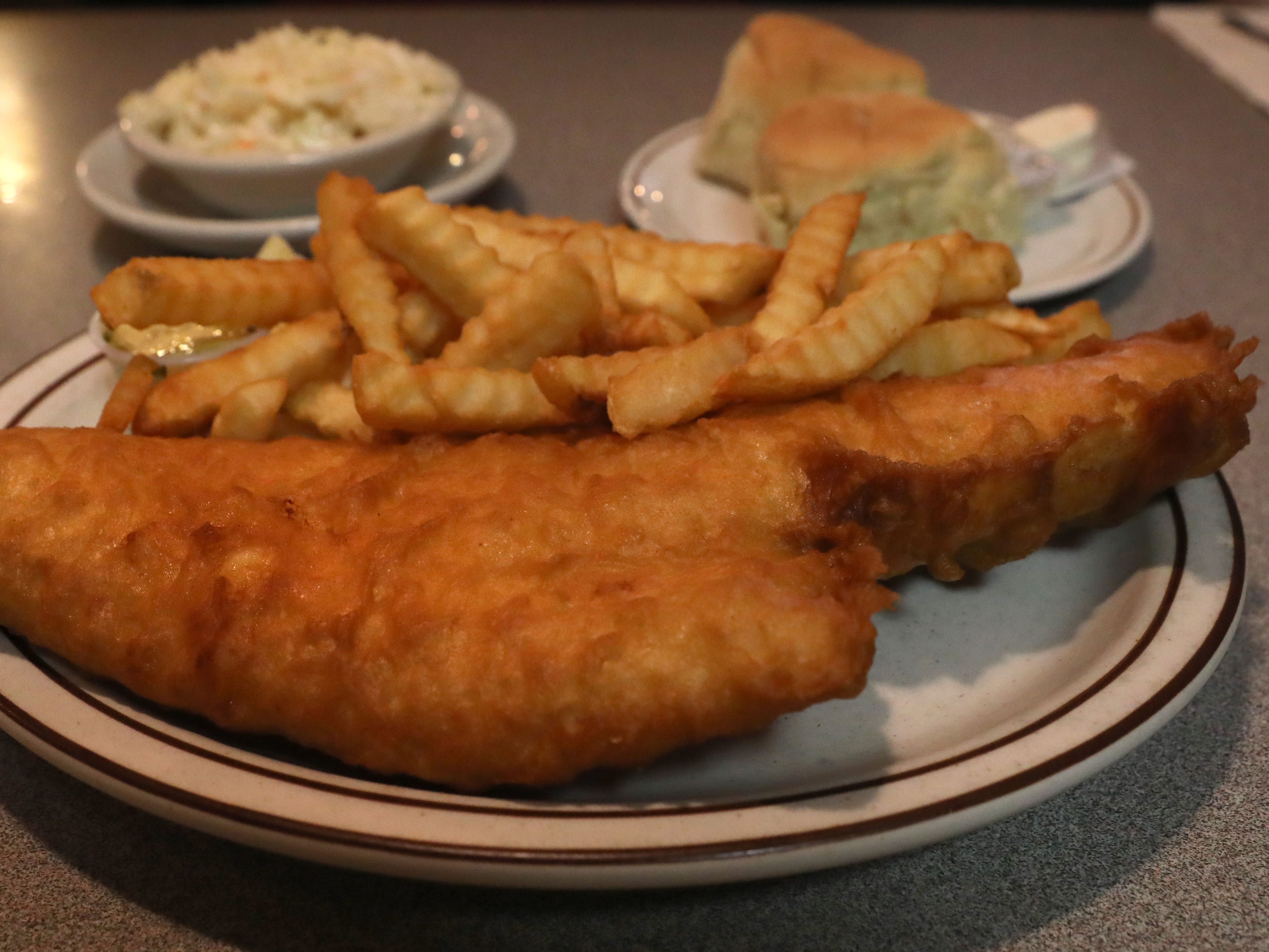 The Parkway Family Restaurant's fish fry included crinkle cut fries, coleslaw and rolls and butter.
