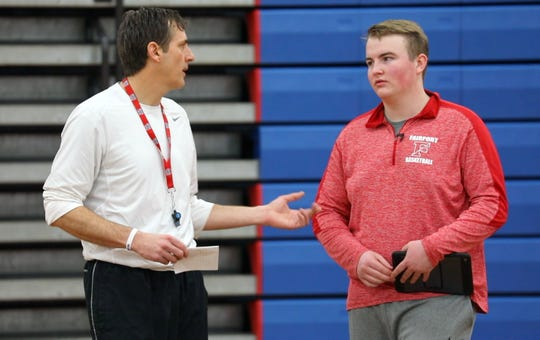 Fairport senior Nick Parker, right, talks with head coach Scott Fitch during practice on Wednesday. Parker uses analytics to provide valuable information to Fitch and hopes to join a Division I team as a manager.