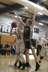 Enterprise freshman Abigail Shoff (14) tries to score from under the rim against Red Bluff's Kennady Sandow during the Hornets' 77-36 win over Red Bluff on Tuesday, Feb. 19, in the Division III Northern Section semifinals.