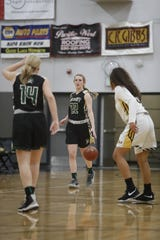 Red Bluff senior Carissa Twitchell takes the ball up the floor against Enterprise during the Hornets' 77-36 win over Red Bluff on Tuesday, Feb. 19, in the Division III Northern Section semifinals.