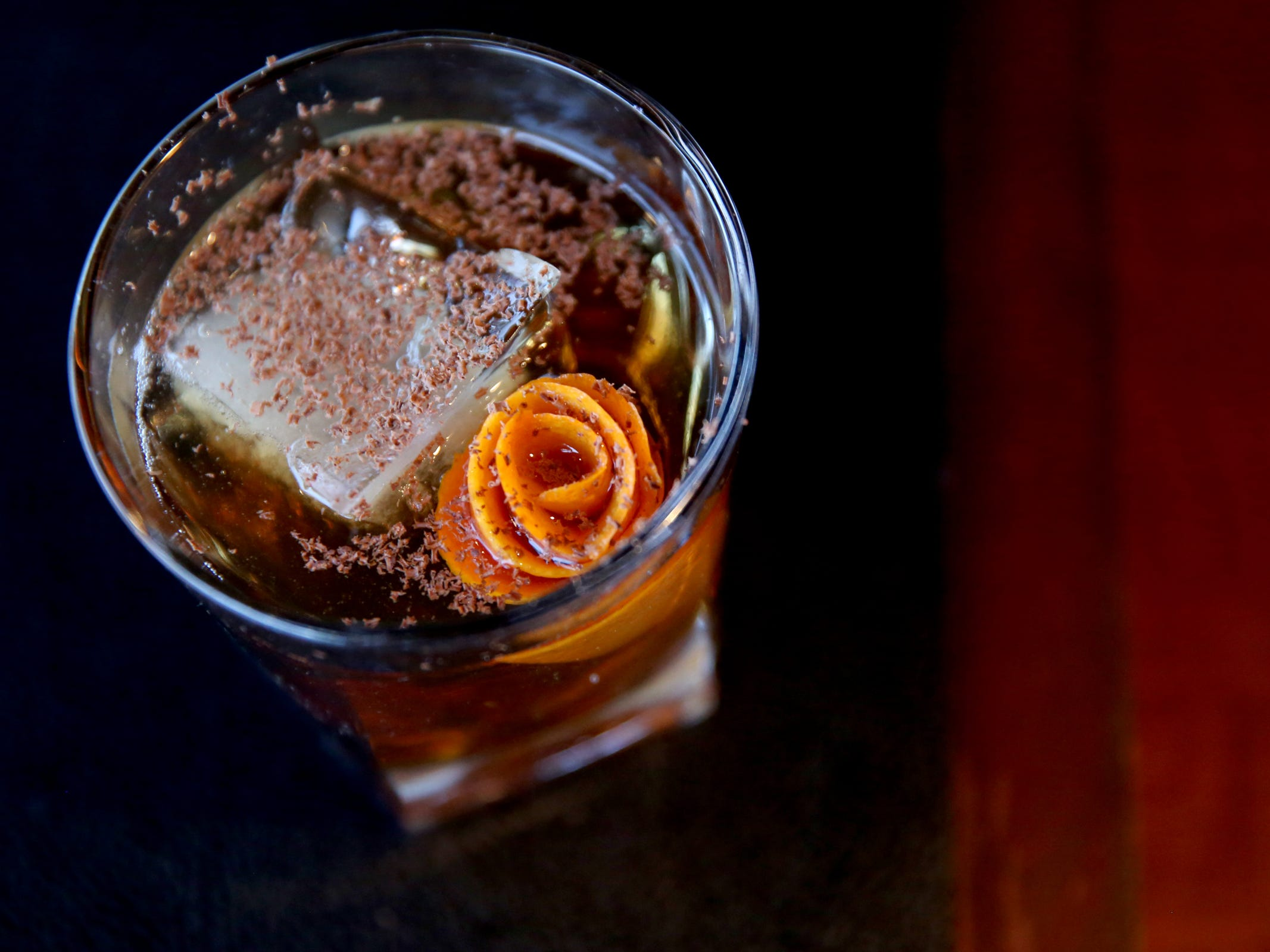 The Chocolate Old Fashioned, with Bushmills, Aztec chocolate bitters, orange peel flower and whiskey syrup at Bentley's Grill in Salem on Friday, Feb. 15, 2019.