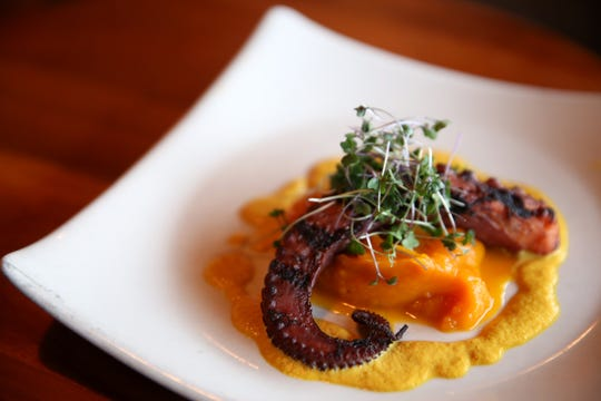 A special, Spanish octopus that is braised, then grilled with roasted butternut squash and an apple curry sauce at Bentley's Grill in Salem on Friday, Feb. 15, 2019.