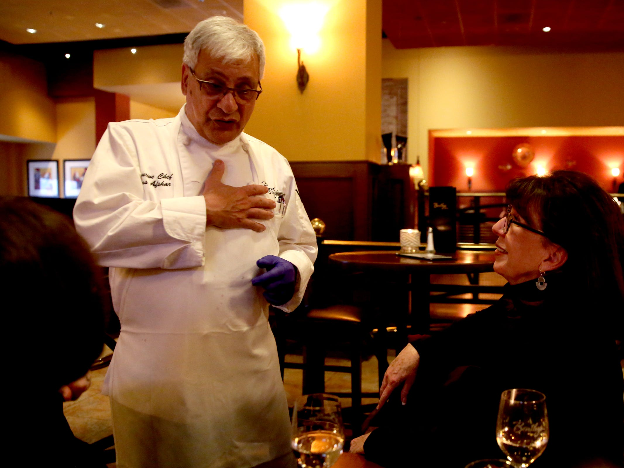 Executive chef Hans Afshar talks with diners Barbara Weber, left, and Linda Menleveld, both of Salem, at Bentley's Grill in Salem on Friday, Feb. 15, 2019.