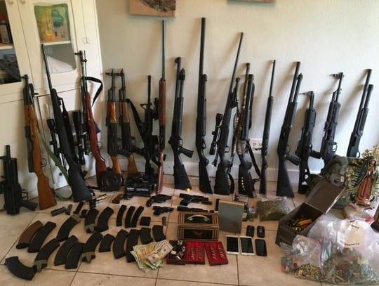 Guns found during a DEA raid at a Salem home.