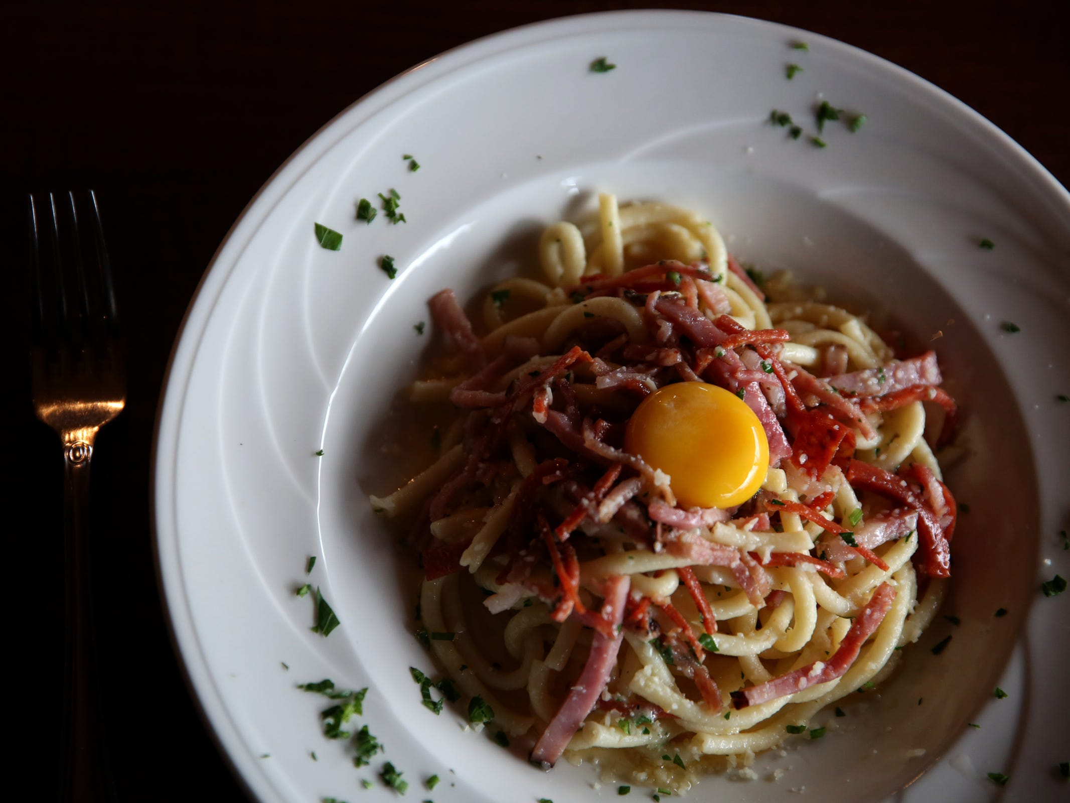 Bucatini carbonara with prosciutto, pancetta, salami, pepperoni, fresh garlic, olive oil, onions, parmesan and egg at Bentley's Grill in Salem on Friday, Feb. 15, 2019.