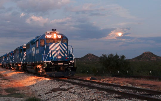 A line of Texas Pacifico locomotives head west along the rail lines that cross Twin Buttes Marina Park Road just outside San Angelo.