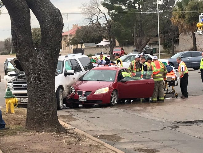 Medics place someone on a stretcher from a Pontiac in a two car wreck in the 300 block of Twohig Wednesday, Feb. 20.