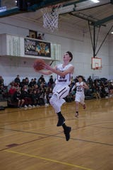 Salisbury Christian's Ben Smith goes in for a layup.