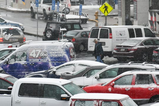 A dusting of snow coats cars in downtown Salisbury on Wednesday, Feb. 20, 2019.