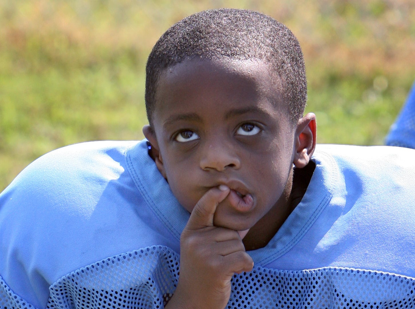 The Salvation Army's Tarheel's running back SaQuan Cotton listens intently to his coaches instructions during the game's halftime.