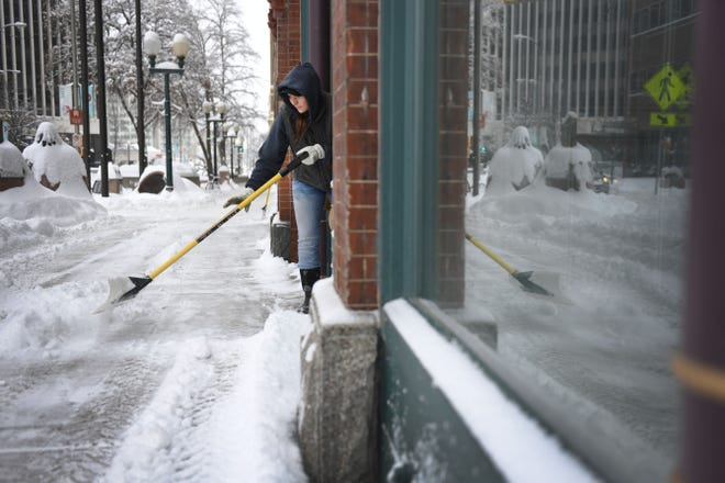 Kristen Martens with Crescent Property Management shovels snow Wednesday, Feb. 20, in Sioux Falls. According to the Sioux Falls national weather service the Sioux Falls airport was at 7.6 inches as of 10:12 a.m.
