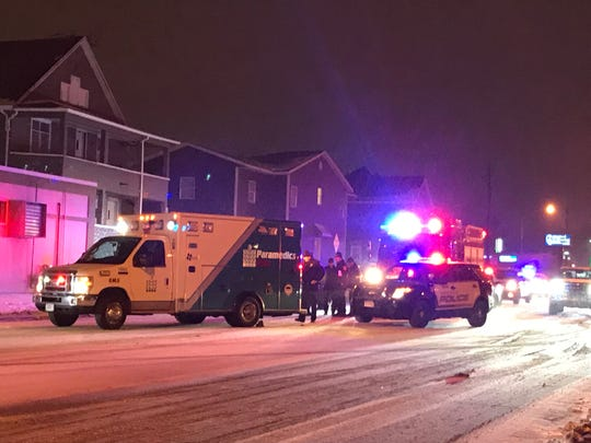 An ambulance came and went from the emergency scene near 14th Street and Main Avenue where police were investigating a shooting Tuesday night.