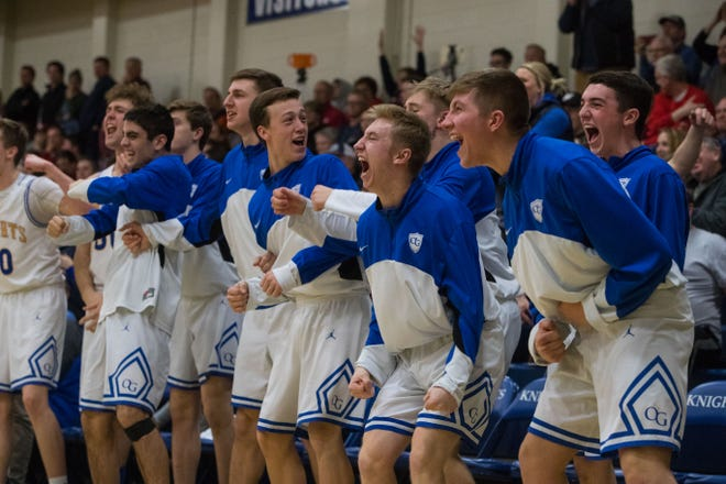O'Gorman players react during a game against Lincoln, Tuesday, Feb. 19, 2019 in Sioux Falls, S.D.