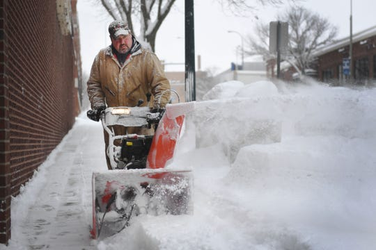James Schoenhard with Schoenhard Lawn Care plows snow Wednesday, Feb. 20, in Sioux Falls. According to the Sioux Falls national weather service the Sioux Falls airport was at 7.6 inches as of 10:12 a.m.
