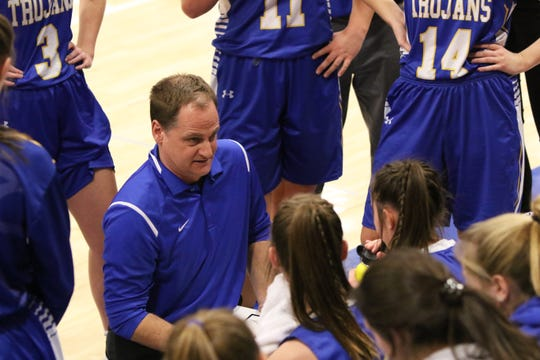 West Central Head Coach, Joe Caffrey talks to his team during a timeout of Tuesday's game against Sioux Falls Christian in Sioux Falls.