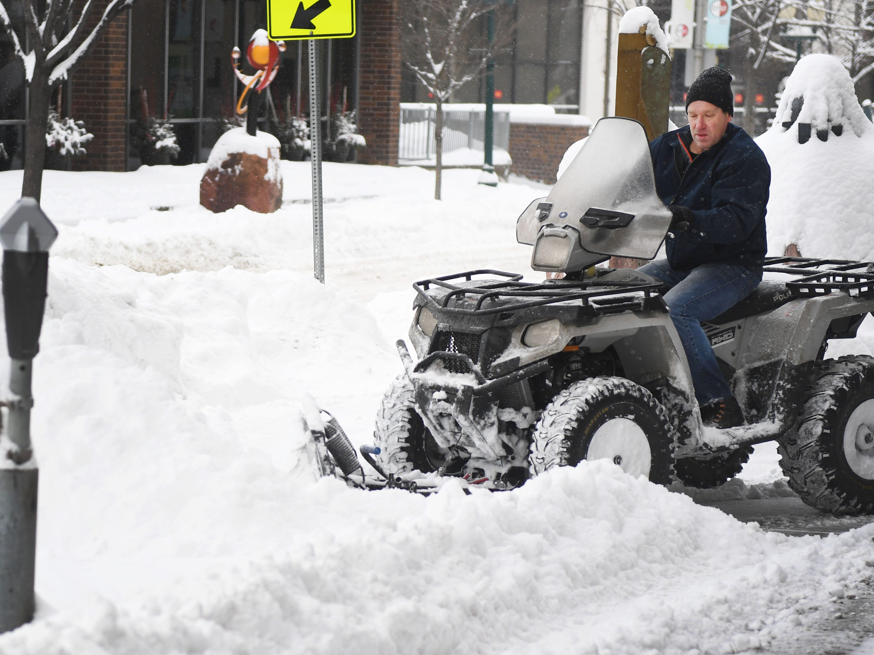 Jeff Vazee with Crescent Property Management plows snow with a four wheeler Wednesday, Feb. 20, in Sioux Falls. According to the Sioux Falls national weather service the Sioux Falls airport was at 7.6 inches as of 10:12 a.m.