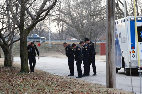 Police investigate a scene in the 1500 block of West Florida Street.