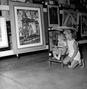 Charles and Catherine Claussen take a look at art displayed at Springfield Art Museum on Aug. 14, 1960.
