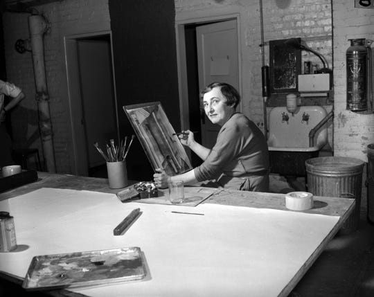 A woman paints in watercolor at a Springfield Art Museum class on Feb. 3, 1952.