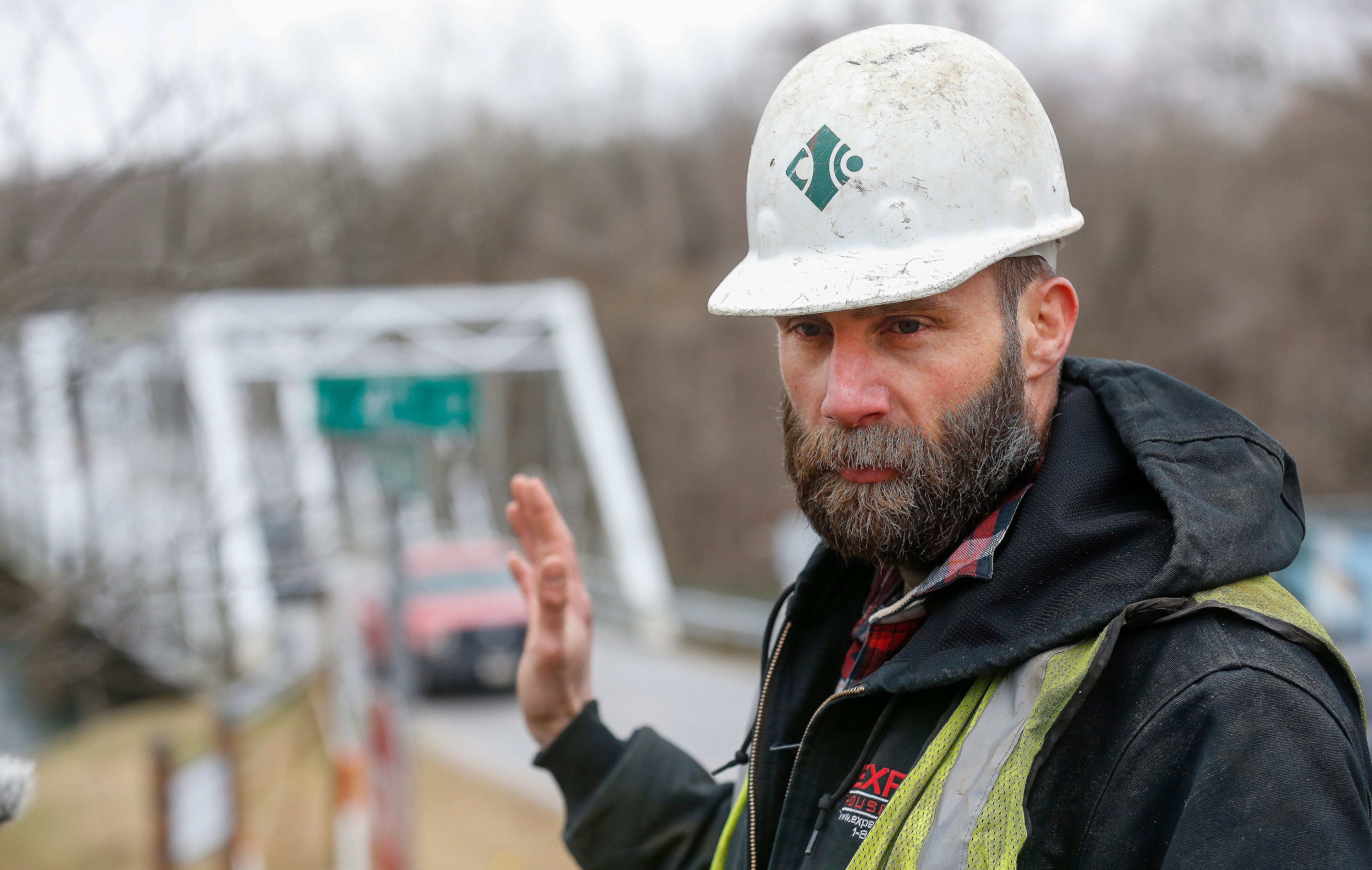 Gabriel Matyiko, of Expert House Movers, talks about the procedure for moving the Ozark Mill back onto its new foundation on Wednesday, Feb. 20, 2019.