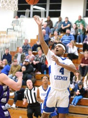 Lee High's Aarian Brown takes a shot Tuesday in the Region 2B boys basketball quarterfinals.