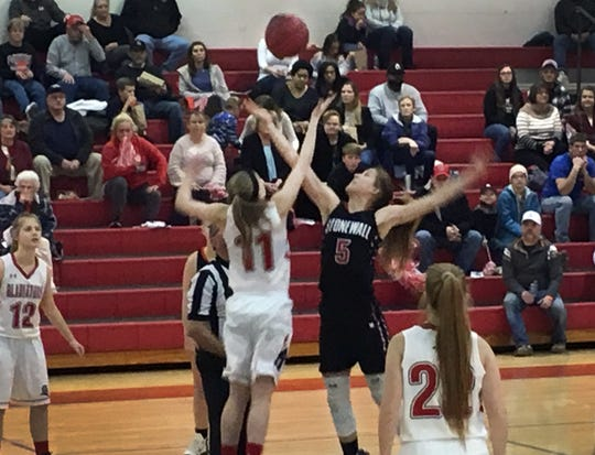 Riverheads' Sara Moore jumps center with Eliana Dellinger of Stonewall Jackson.