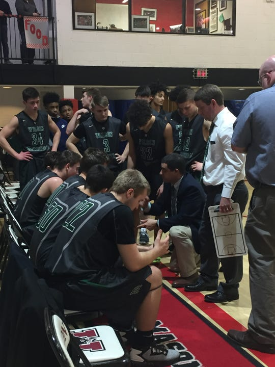 Wilson Memorial coach Jeremy Hartman talks with his team Tuesday during a timeout in the Region 2B quarterfinals at George Mason.