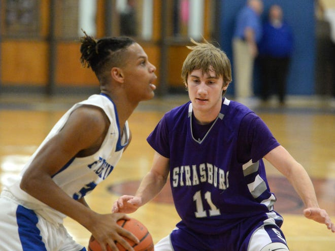 Strasburg's Dylan Hamrick guards Lee High's Kyiam Brown Tuesday in the Region 2B boys basketball quarterfinals.