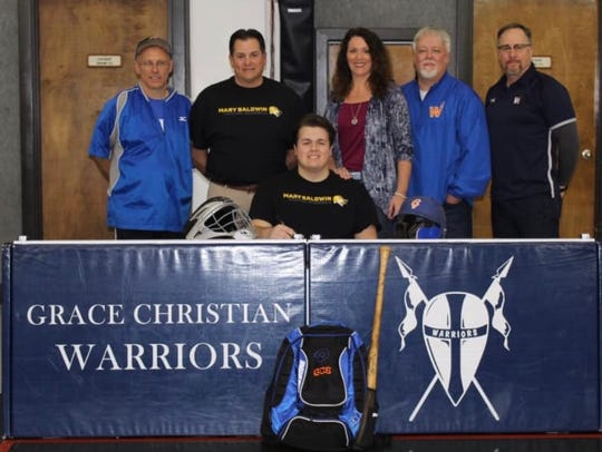 Grace Christian senior Hagen Allred recently had a ceremony to announce that he'll play baseball for Mary Baldwin University next spring. Behind Allred are, from left, Grace baseball coach Mike Mallory, dad Wes Allred, mom Monya Decker, Grace athletic director Frank Kahrs, and Grace headmaster Donald Larson.