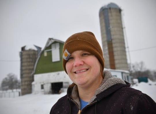 Brenda Rudolph smiles while spending some time outside Wednesday, Feb. 20, on her family's farm near Little Falls.