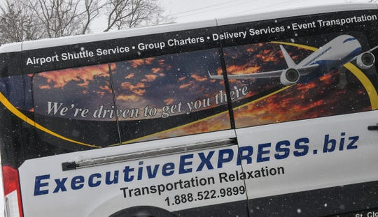 An Executive Express vehicle is loaded for its trip to the Minneapolis-St. Paul International Airport Wednesday, Feb. 20, at the company's headquarters in Waite Park.