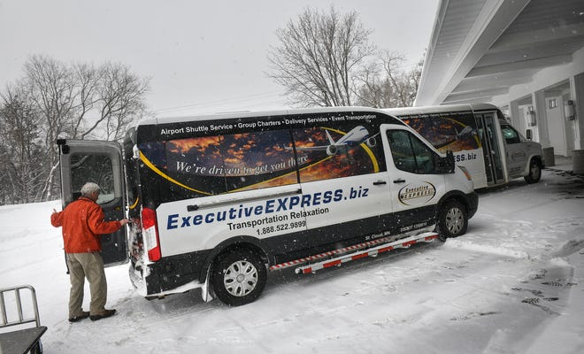 Executive Express vehicles are loaded for their trip to the Minneapolis-St. Paul International Airport Wednesday, Feb. 20, at the company's headquarters in Waite Park.