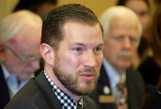 Rep. Andrew Stoddard, D-Sandy, speaks to members of the House Law Enforcement and Criminal Justice Standing Committee Wednesday, Feb. 20, 2019, in Salt Lake City. State lawmakers are pressing pause on two gun measures, including a proposal inspired by the shooting death of University of Utah student Lauren McCluskey. Democratic sponsor Stoddard said he's planning to keep working on the measure that would hold gun owners liable if they lend out a firearm that's used in a crime. Stoddard's measure stalled out after hitting opposition from gun-rights advocates, as did another to penalize gun owners if someone is hurt by a firearm that isn't safely stored.  (AP Photo/Rick Bowmer)