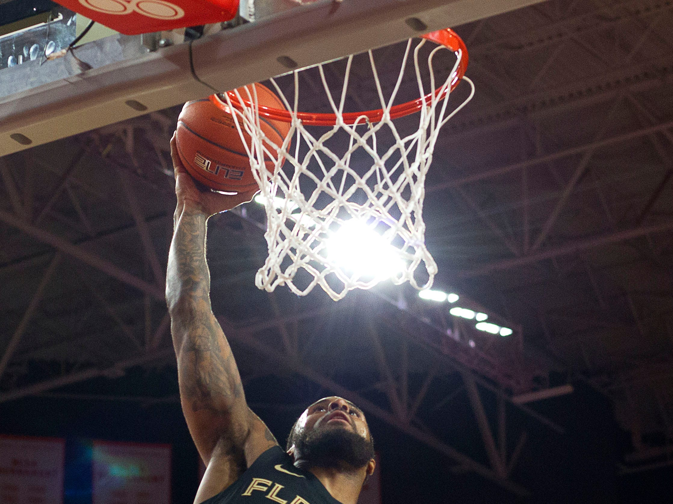 Feb 19, 2019; Clemson, SC, USA; Florida State Seminoles forward Phil Cofer (0) dunks the ball during the first half against the Clemson Tigers at Littlejohn Coliseum. Mandatory Credit: Joshua S. Kelly-USA TODAY Sports