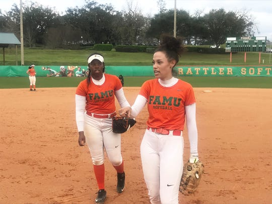 FAMU senior first baseman Taylor Rosier (right) discusses strategy in practice while pitcher Kyaira Brown observes.