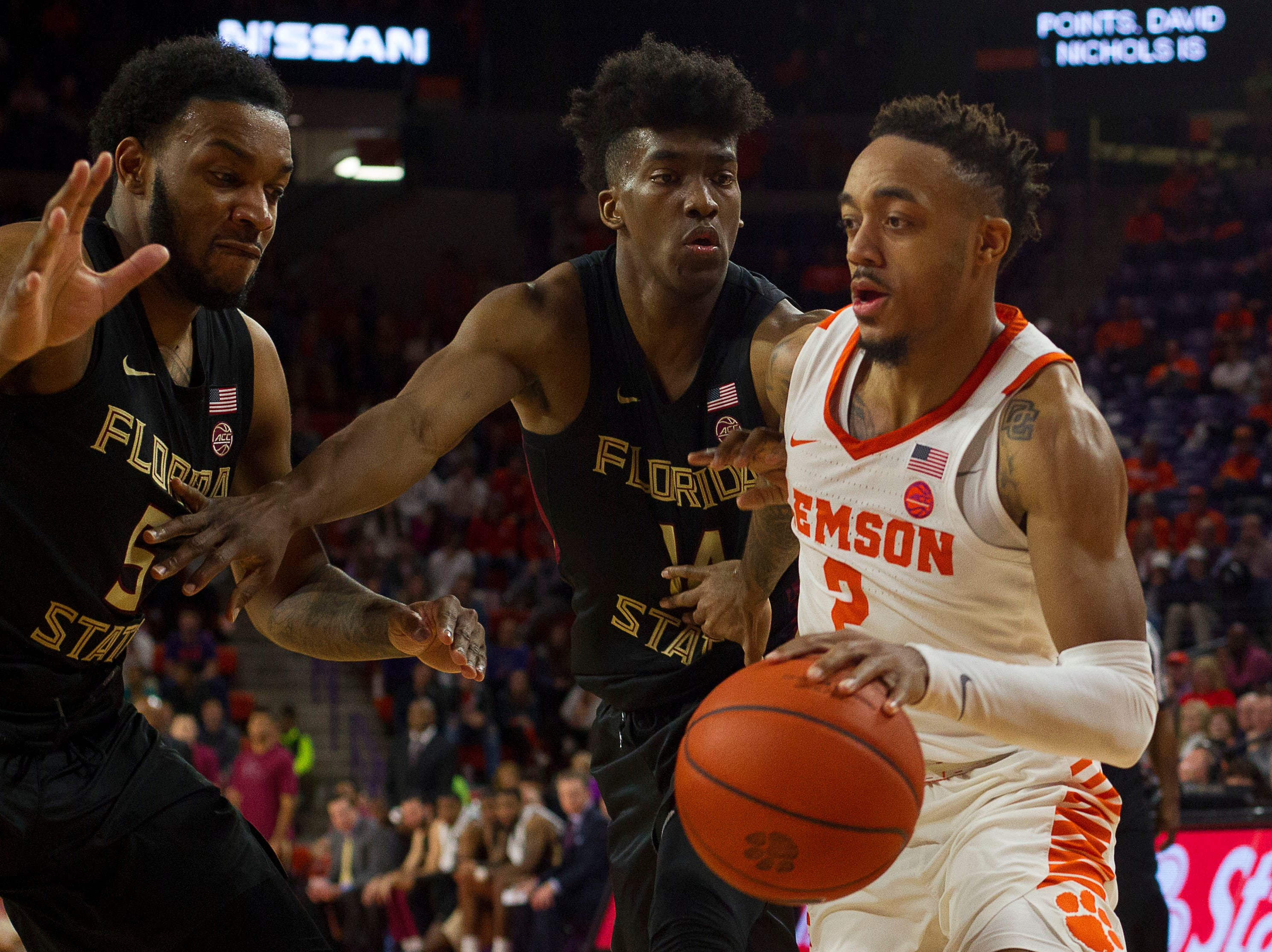 Feb 19, 2019; Clemson, SC, USA; Clemson Tigers guard Marcquise Reed (2) attempts to drive to the basket while being defended by Florida State Seminoles guard Terance Mann (14) during the second half at Littlejohn Coliseum. Seminoles won 77-64. Mandatory Credit: Joshua S. Kelly-USA TODAY Sports