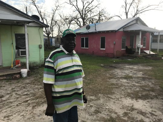 Amos Pittman surveys the damage to his properties on Avenue G in the historically black Millview subdivision in North Port St. Joe.