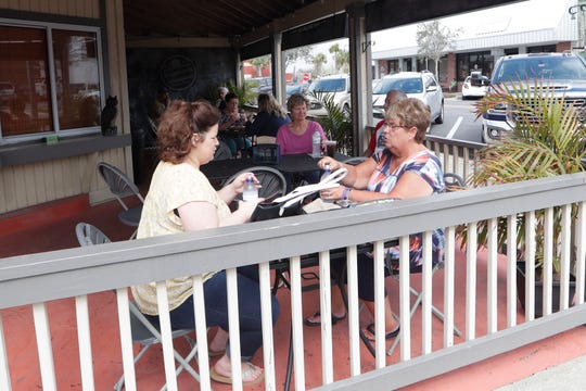 Kristin Booher, left, and her mother Carol Booher enjoy lunch at Dogwood's in Port St. Joe, Fla., Wednesday Feb. 20, 2019. Many businesses along Reid Avenue are open for business and welcoming tourists back as the city continues to rebuild from the damage caused by Hurricane Michael in Oct. 2018. .