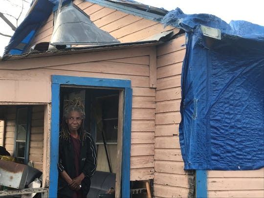 Diane Morgan stands in the doorway of her friend Earl Williams' house on Avenue A in the historically black neighborhood of North Port St. Joe