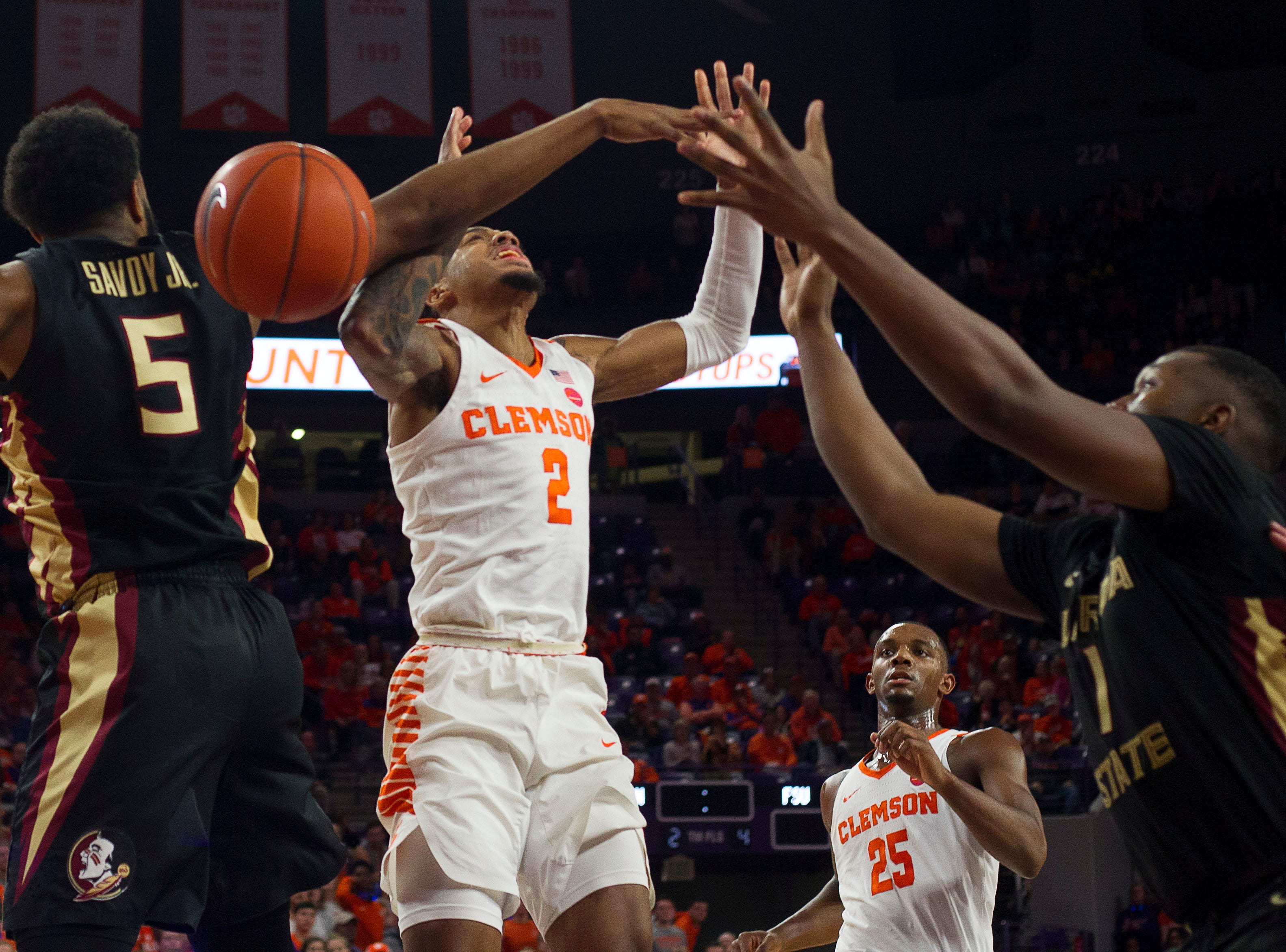 Feb 19, 2019; Clemson, SC, USA; Clemson Tigers guard Marcquise Reed (2) attempts the layup while being defended by Florida State Seminoles guard PJ Savoy (5) during the second half at Littlejohn Coliseum. Seminoles won 77-64. Mandatory Credit: Joshua S. Kelly-USA TODAY Sports
