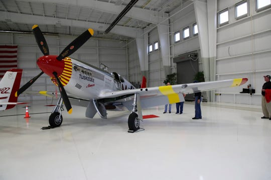 A P-51 C Mustang plane, flown by the Tuskegee Airmen in World War II is on display in the Flightline hangar at the Tallahassee International Airport as part of the RISE ABOVE: Red Tail Traveling Exhibit.